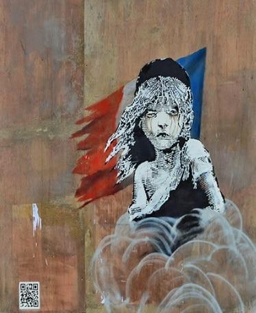grafite censurado - que critica  tratamento dado a refugiados